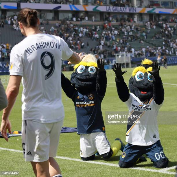 Los Angeles Galaxy mascots Cozmo Bro and Cozmo worship their new hero Zlatan Ibrahimovic of Los Angeles Galaxy during the MLS match between Los...