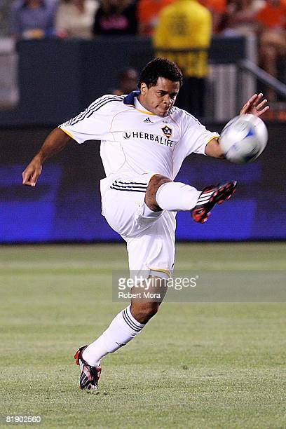 Los Angeles Galaxy midfielder Alvaro Pires extends to gain control of the ball against the defense of CD Chivas USA during their MLS game at Home...