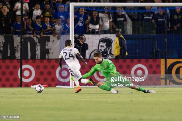 Los Angeles Galaxy midfielder Ema Boateng scores against Houston Dynamo goalkeeper Tyler Deric during the game between the LA Galaxy and the Houston...