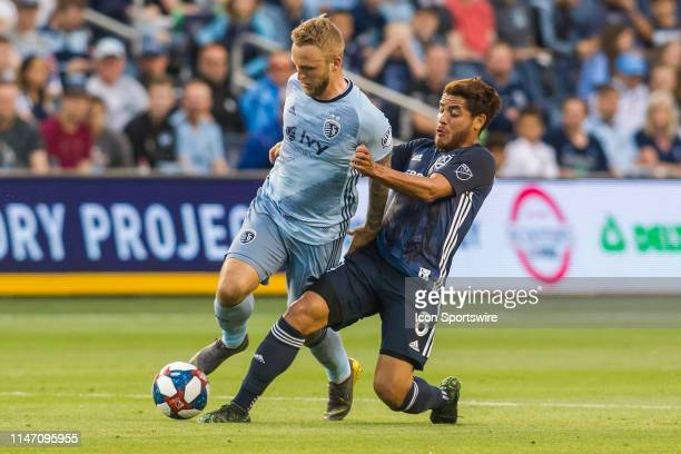 Los Angeles Galaxy midfielder Jonathan dos Santos attempts to disrupt the run of Sporting Kansas City forward Johnny Russell during the match between...