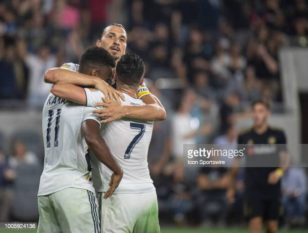 Los Angeles Galaxy midfielder Jonathan dos Santos top left forward Ola Kamara and midfielder Romain Alessandrini celebrate Kamara's goal in the...
