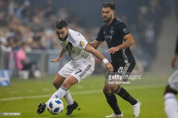 Los Angeles Galaxy midfielder Romain Alessandrini attempts to shield off Sporting Kansas City midfielder Graham Zusi during the MLS regular season...