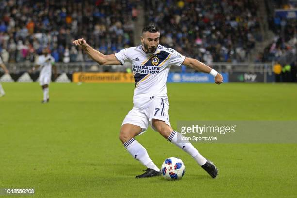 Los Angeles Galaxy midfielder Romain Alessandrini centers the ball in the first half of an MLS match between the LA Galaxy and Sporting Kansas City...