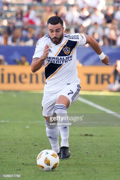 Los Angeles Galaxy midfielder Romain Alessandrini dribbles with the ball during a MLS game between the Seattle Sounders and Los Angeles Galaxy on...