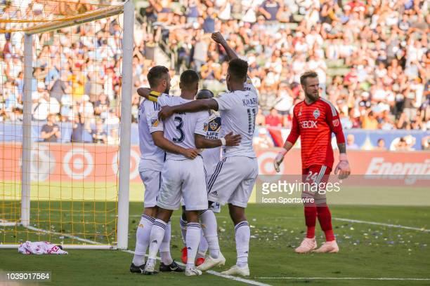 Los Angeles Galaxy midfielder Romain Alessandrini Los Angeles Galaxy defender Ashley Cole and Los Angeles Galaxy forward Ola Kamara celebrate after...