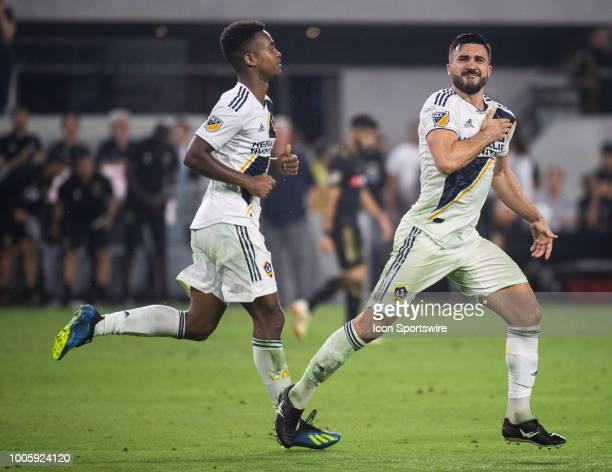 Los Angeles Galaxy midfielder Romain Alessandrini right celebrates his goal in the second half during a MLS match between the Los Angeles FC and the...
