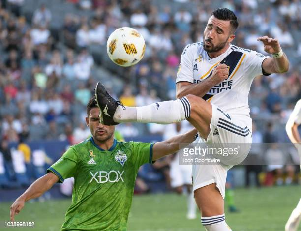Los Angeles Galaxy midfielder Romain Alessandrini right wins the ball in he air over Seattle Sounders midfielder Cristian Roldan during the MLS...