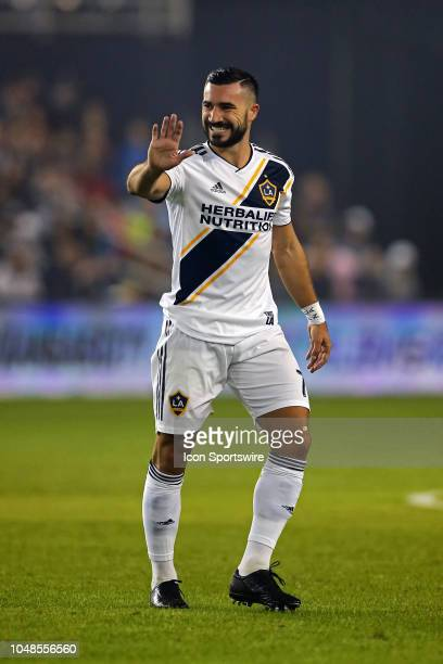 Los Angeles Galaxy midfielder Romain Alessandrini smiles after missing a shot high in the first half of an MLS match between the LA Galaxy and...