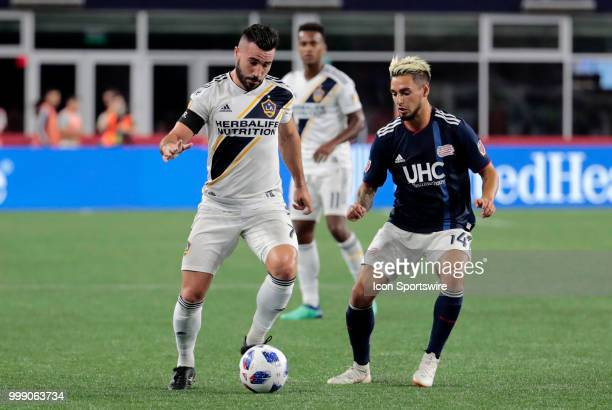 Los Angeles Galaxy midfielder Romain Alessandrini watched by New England Revolution midfielder Diego Fagundez during a match between the New England...