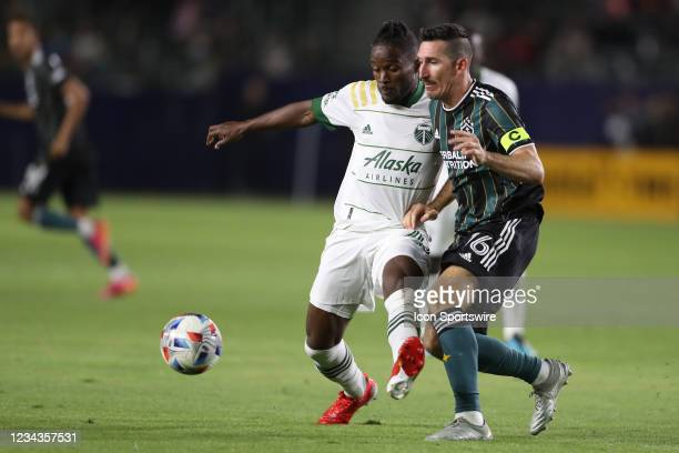 Los Angeles Galaxy midfielder Sacha Kljestan and Portland Timbers midfielder Marvin Loria battle for the ball in the second half during the game...