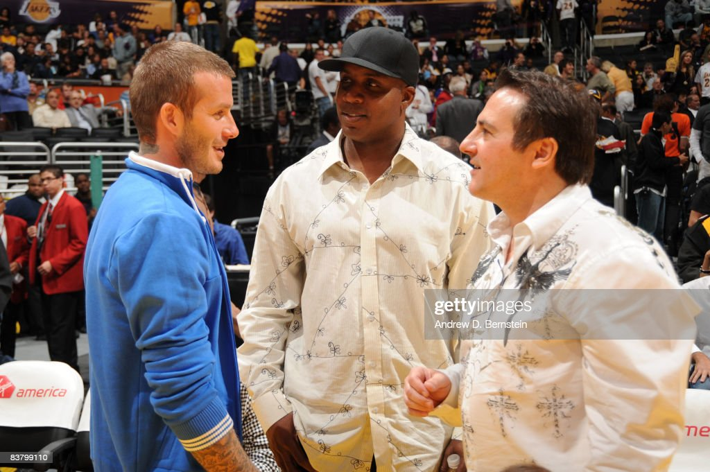 Los Angeles Galaxy player David Beckham, former MLB player Barry Bonds, and Co-owner Gavin Maloof of the Sacramento Kings speak to each other during a break in the action of the game between the Sacramento Kings and the Los Angeles Lakers at Staples Center on November 23, 2008 in Los Angeles, California.