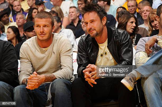Los Angeles Galaxy player David Beckham sits courtside with actor David Arquette during the game between the Chicago Bulls and the Los Angeles Lakers...