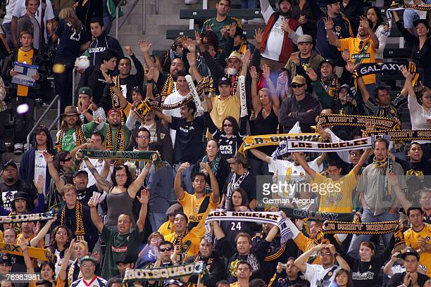 Los Angeles Galaxy team supporters celebrate goal scored by Chris Klein during today's match against the FC Dallas at the Home Depot Center on...