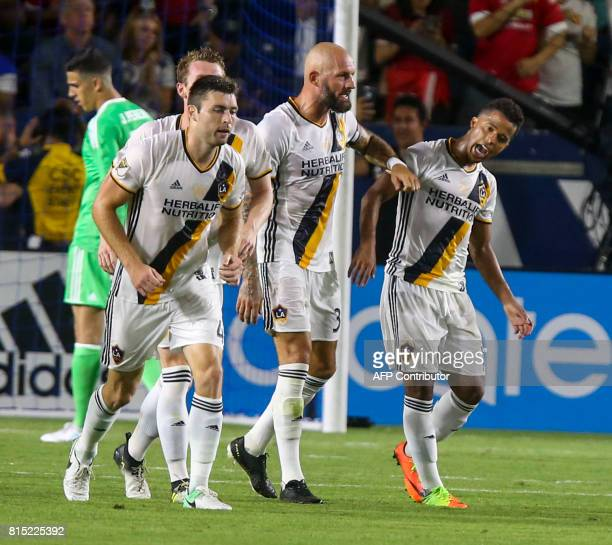 Los Angeles Galaxy's Dave Romney and Jelle Van Damme celebrate a goal with other team mates against Manchester United during the second half of a...