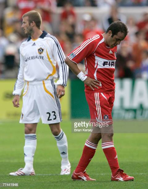 Los Angeles Galaxy's David Beckham and Chicago Fire's Cuauhtemoc Blanco stand on the field during the second half of an MLS game at Toyota Park on...