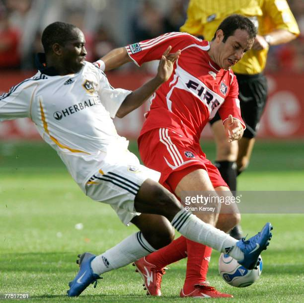 Los Angeles Galaxy's Mike Randolph tries to kick the ball away from Chicago Fire's Cuauhtemoc Blanco during the second half of an MLS game at Toyota...