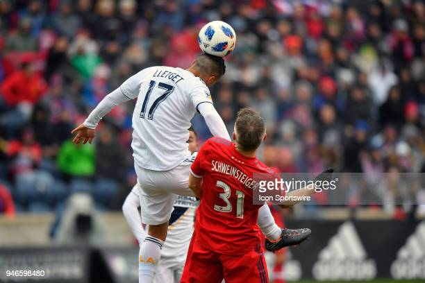 Los Angeles Galaxy's Sebastian Lletget heads the ball against Chicago Fire's Bastian Schweinsteiger on April 14 2018 at Toyota Park in Bridgeview...