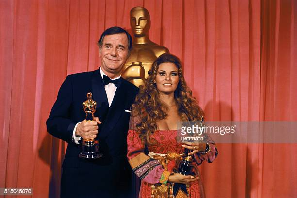 """Los Angeles: Gig Young holds Oscar he won for """"best supporting actor of 1969"""" for his role in They Shoot Horses, Don't They? during Academy Awards..."""