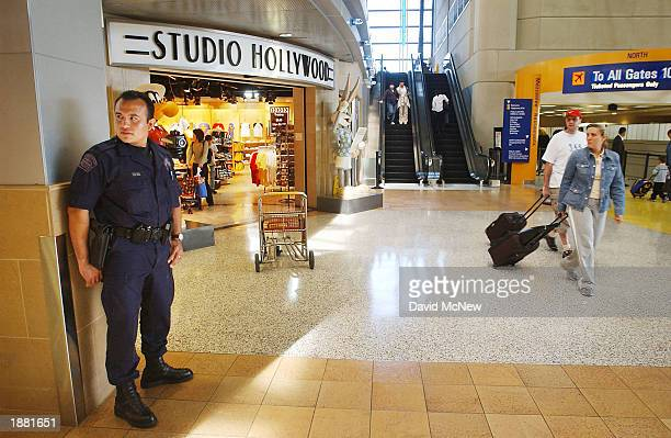 Los Angeles International Airport police officer standing guard inside the Bradley International Terminal between Studio Hollywood and the El Al...