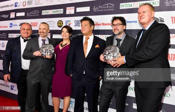 Los Angeles Italia Film Fashion and Art Fest President Pascal Vicedomini presents award to 'Bohemian Rhapsody's' John Warhurst Nina Hartsone Tim...