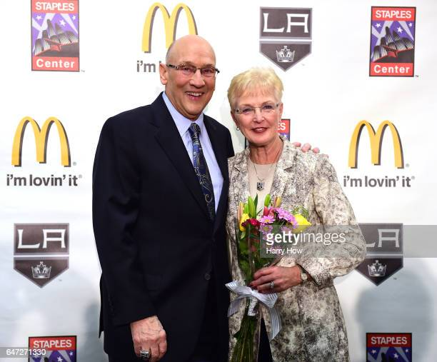 Los Angeles King's announcer Bob Miller poses for a photo with his wife Judy during his press conference to announce his retirement at the end of the...