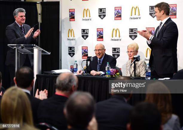 Los Angeles King's announcer Bob Miller receives an ovation from members of the press announcer NickNickson and President of business operations for...