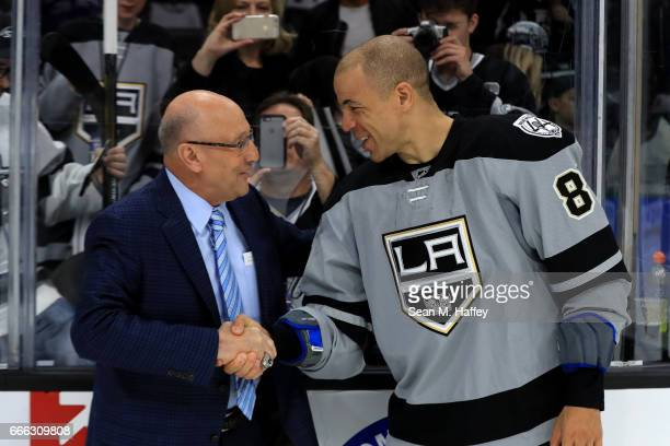 Los Angeles Kings broadcaster Bob Miller shakes hands with Jarome Iginla of the Los Angeles Kings after a game against the Chicago Blackhawks at...