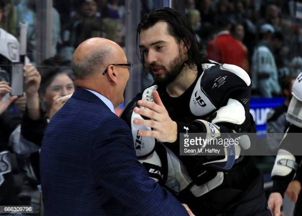 Los Angeles Kings broadcaster Bob Miller shakes hands withDrew Doughty of the Los Angeles Kings after a game against the Chicago Blackhawks at...
