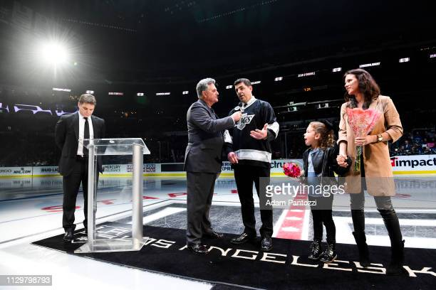 Los Angeles Kings broadcaster Nick Nickson interviews former Kings defenseman Sean O'Donnell as Kings President Luc Robitaille and O'Donnell's wife...