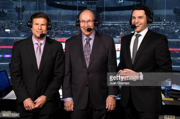 Los Angeles Kings broadcasters Jim Fox and Alex Faust call the game as former Kings announcer Bob Miller visits the broadcasting booth during the...