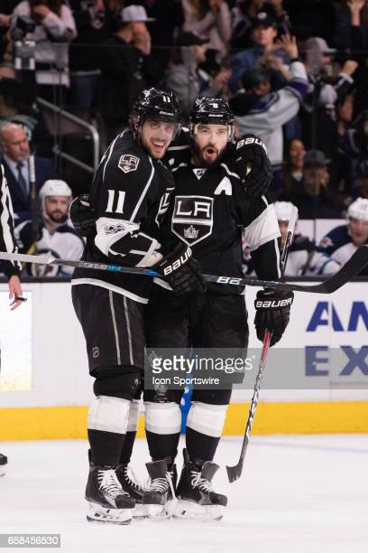 Los Angeles Kings Center Anze Kopitar and Los Angeles Kings Defenceman Drew Doughty celebrate after a goal during the game between the Winnipeg Jets...
