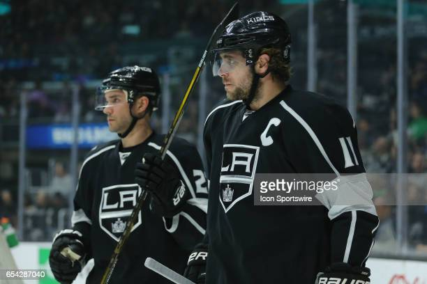 Los Angeles Kings Center Anze Kopitar and Los Angeles Kings Winger Trevor Lewis look all business as they face off again the Buffalo Sabres in the...