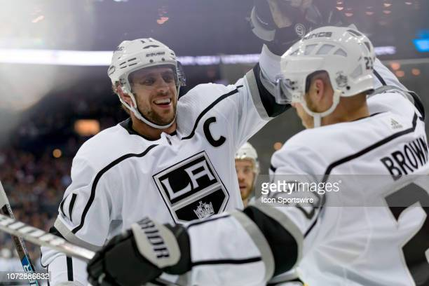 Los Angeles Kings center Anze Kopitar celebrates with Los Angeles Kings right wing Dustin Brown after Brown scored a goal in a game between the...
