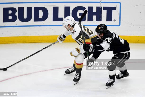 Los Angeles Kings Center Jaret Anderson-Dolan and Vegas Golden Knights Defenceman Shea Theodore battle for the puck during an NHL game between the...
