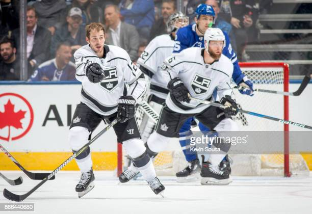Los Angeles Kings center Nick Shore skates with no helmet against in front of goalie Jonathan Quick at an NHL game against the Toronto Maple Leafs...