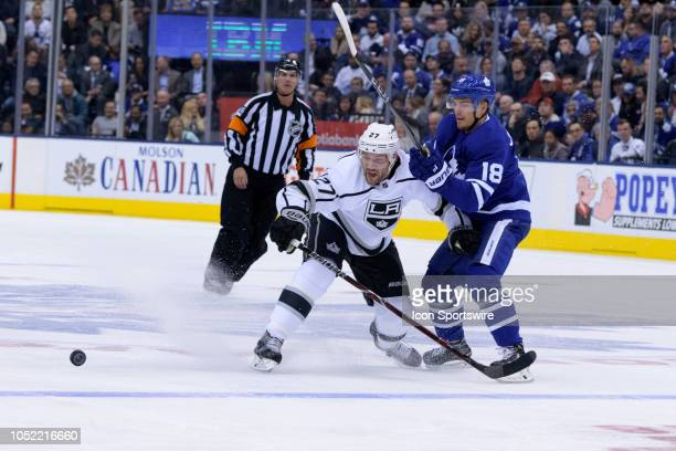 Los Angeles Kings Defenceman Alec Martinez and Toronto Maple Leafs Left Wing Andreas Johnsson battle for the puck during the first period of the NHL...