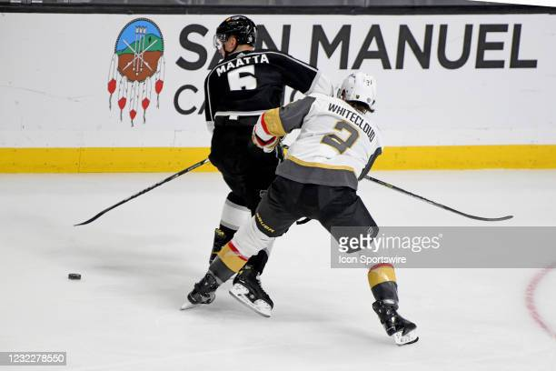 Los Angeles Kings Defenceman Olli Maatta and Vegas Golden Knights Defenceman Zach Whitecloud battle for the puck during an NHL game between the Las...