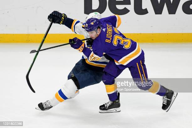 Los Angeles Kings Defenceman Tobias Bjornfot and St. Louis Blues Right Wing Vladimir Tarasenko battle for position during a National Hockey League...