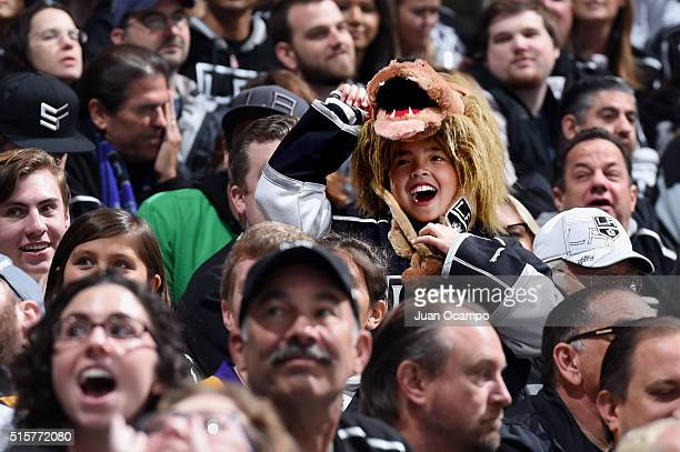 Los Angeles Kings fans cheers during an intermission of the game against the Anaheim Ducks on March 5, 2016 at Staples Center in Los Angeles,...
