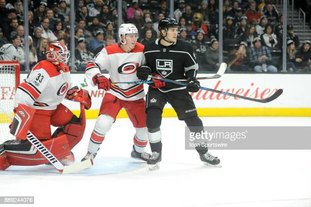 Los Angeles Kings forward Adrian Kempe battles for position with Hurricanes defenseman Haydn Fleury in front of goaltender Scott Darling during the...