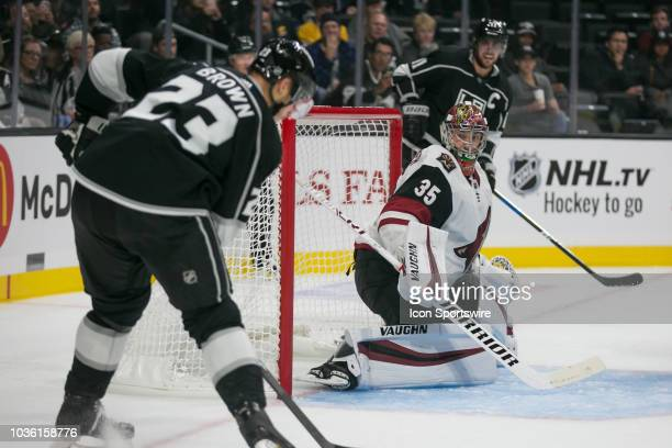 Los Angeles Kings forward Dustin Brown receives a pass from Los Angeles Kings forward Anze Kopitar as Arizona Coyotes goaltender Darcy Kuemper...