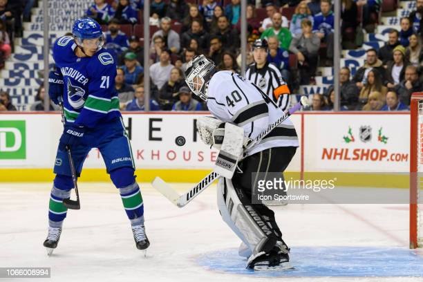 Los Angeles Kings Goalie Cal Petersen and Vancouver Canucks Left wing Loui Eriksson watch the puck during their NHL game at Rogers Arena on November...