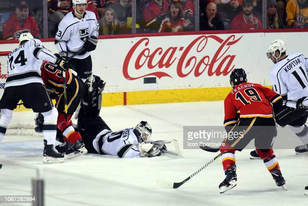 Los Angeles Kings Goalie Cal Petersen lunges to cover the puck during the third period of an NHL game where the Calgary Flames hosted the Los Angeles...