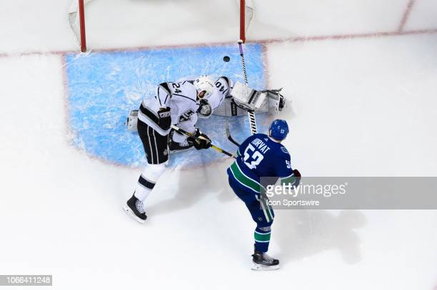 Los Angeles Kings Goalie Cal Petersen makes a save on Vancouver Canucks Center Bo Horvat as Los Angeles Kings Defenceman Derek Forbort defends during...