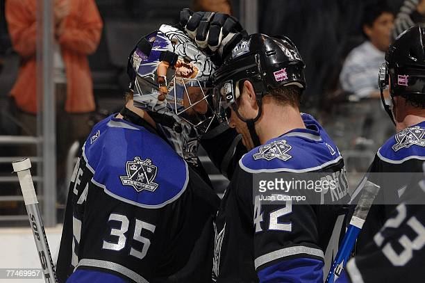 Los Angeles Kings goalie Jason LaBarbera is congratulated by Tom Preissing after LaBarbera's 60 shutout of the Nashville Predators at the Staples...