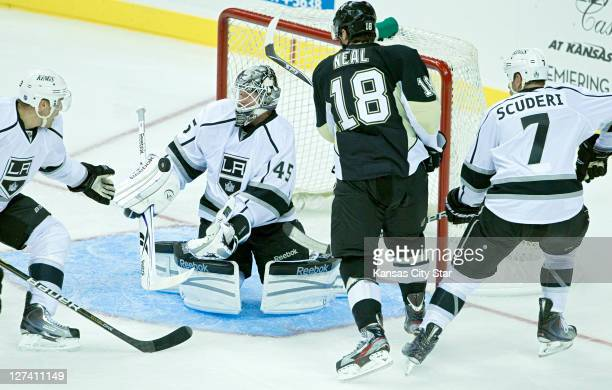 Los Angeles Kings goalie Jonathan Bernier stops a shot on goal by Pittsburgh Penguins left wing James Neal during Tuesday's preseason hockey game on...