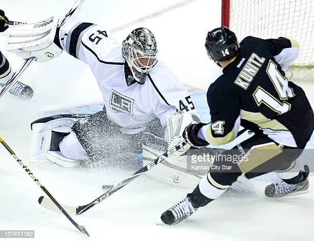 Los Angeles Kings goalie Jonathan Bernier stops a shot on goal by Pittsburgh Penguins left wing Chris Kunitz during Tuesday's preseason hockey game...
