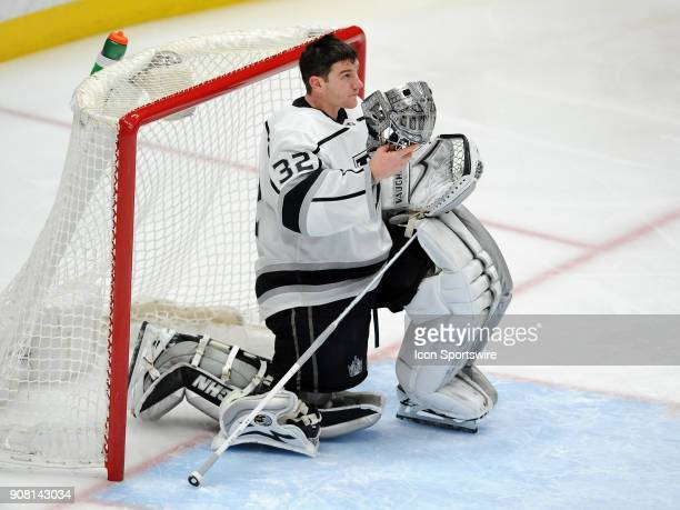 Los Angeles Kings goalie Jonathan Quick adjusts his helmet after the Ducks scored a goal in the third period of a game against the Anaheim Ducks...