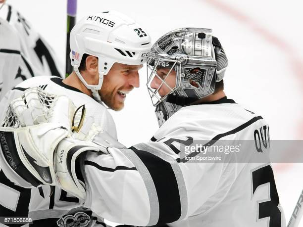 Los Angeles Kings goalie Jonathan Quick and center Brooks Laich celebrate after the Kings defeated the Anaheim Ducks in overtime 4 to 3 in a game...
