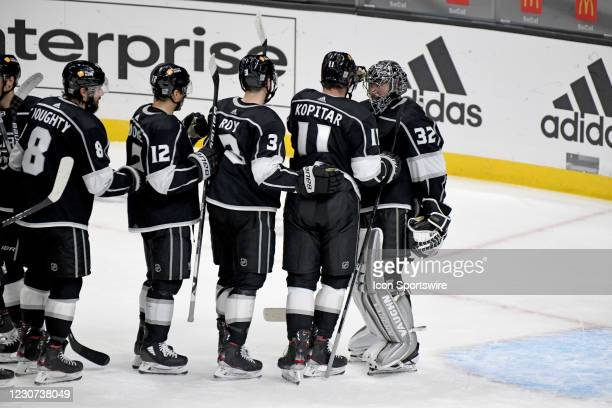 Los Angeles Kings Goalie Jonathan Quick is congratulated by teammates Center Anze Kopitar , Defenceman Matt Roy , Left Wing Trevor Moore , and Kings...